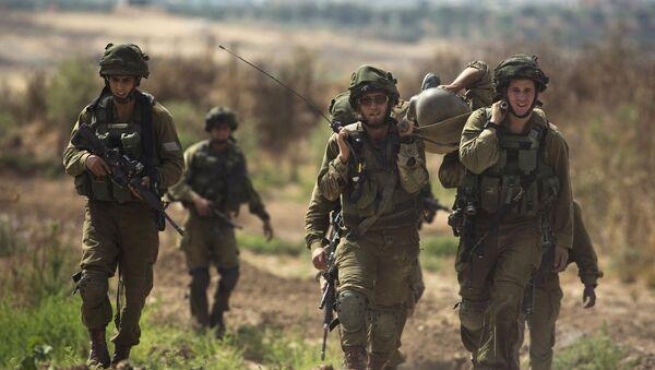 Soldados israelíes al lado de la frontera de Franja de Gaza, el 7 de junio, 2015 - Sputnik Mundo