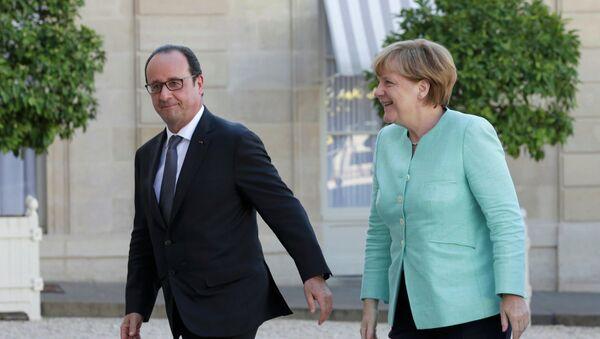 Presidente de Francia, François Hollande, y canciller de Alemania, Angela Merkel - Sputnik Mundo