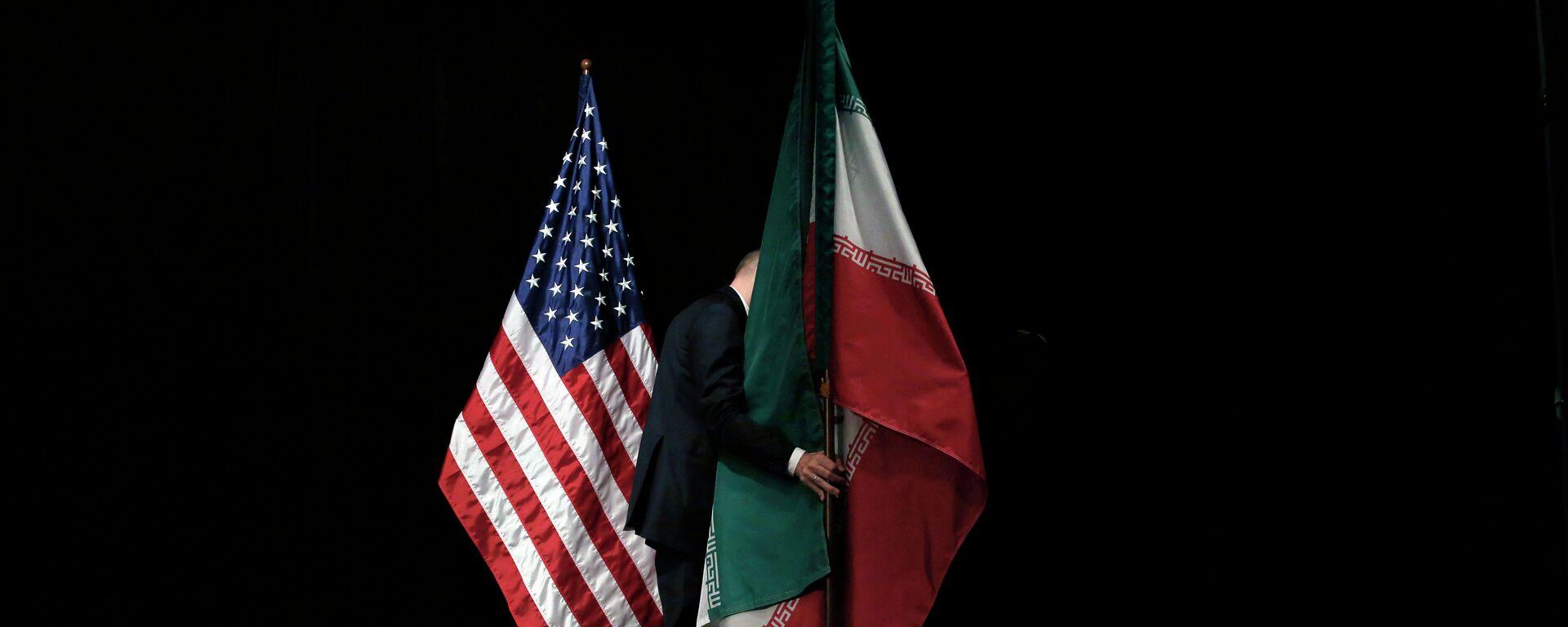 Banderas de EEUU e Irán - Sputnik Mundo, 1920, 18.02.2021