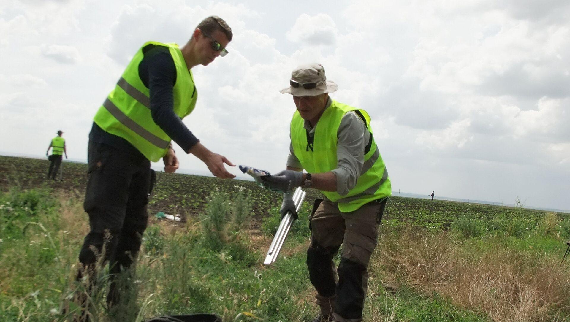 Lugar de la catástrofe del vuelo de MH17 en Ucrania - Sputnik Mundo, 1920, 09.02.2021