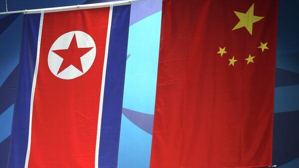 Banderas de Japón y Corea del Norte - Sputnik Mundo