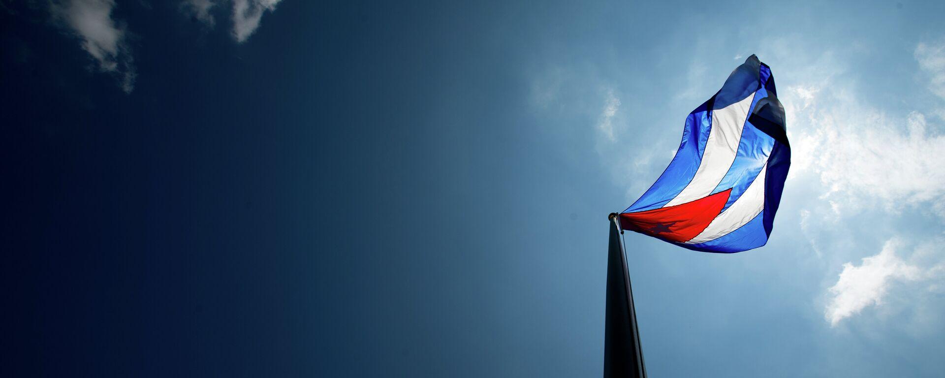 The Cuban flag over their new embassy in Washington, Monday, July 20, 2015. - Sputnik Mundo, 1920, 12.10.2021