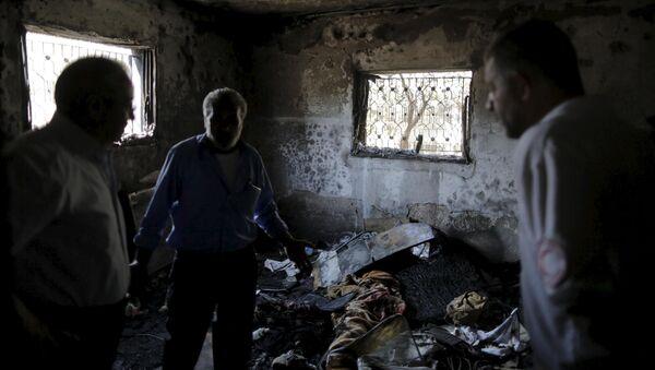 Casa encendida por los terroristas judíos cerca de la ciudad de Nablus, el 31 de julio, 2015 - Sputnik Mundo