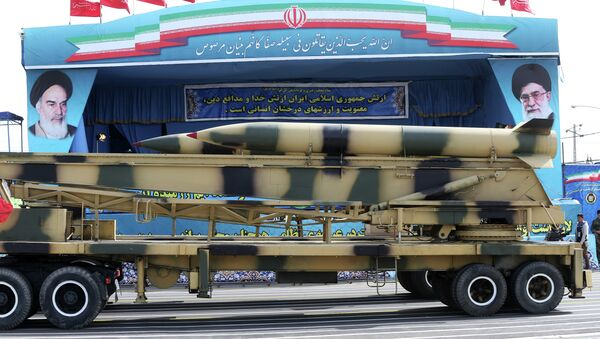 In this Saturday, April 18, 2015 file photo, a missile is displayed by the Iranian army in front of a portrait of supreme leader Ayatollah Ali Khamenei during a parade marking National Army Day at the mausoleum of the late revolutionary founder Ayatollah Khomeini, just outside Tehran, Iran. - Sputnik Mundo