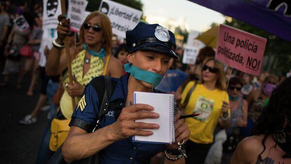 Protesta contra la 'ley mordaza' en Madrid, el 30 de junio, 2015 - Sputnik Mundo
