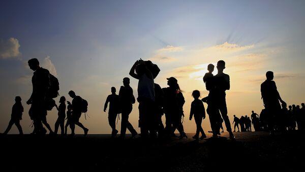 Los refugiados sirios en Europa - Sputnik Mundo