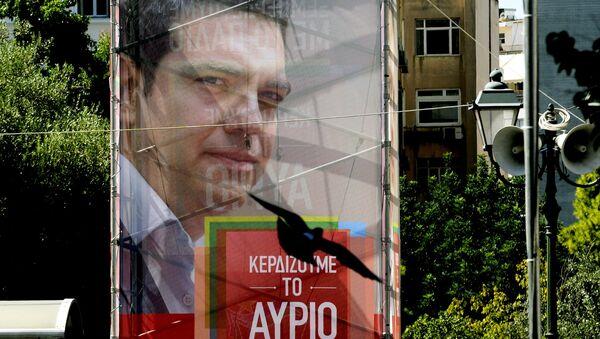 Сartel con la imagen del líder de Syriza, Alexis Tsipras - Sputnik Mundo