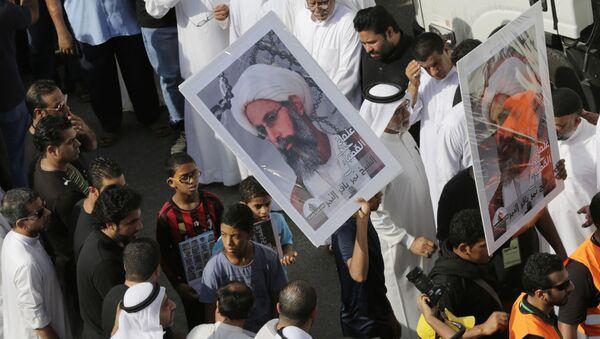 Imágenes del clérigo chií Nimr Baqir al Nimr durante una manifestación en Arabia Saudí (archivo) - Sputnik Mundo