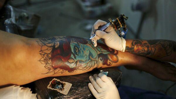 Tatuaje - Sputnik Mundo