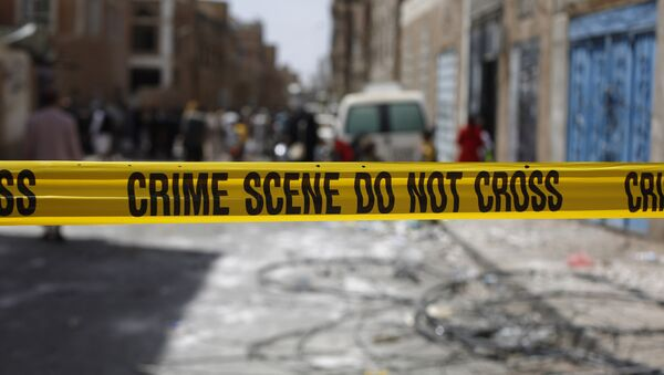 Police tape cordons off the site of a car bomb attack in Sanaa, Yemen, Tuesday, June 30, 2015. - Sputnik Mundo