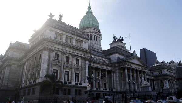 A man rides his motorcycle past the Argentine Congress in Buenos Aires, Argentina - Sputnik Mundo