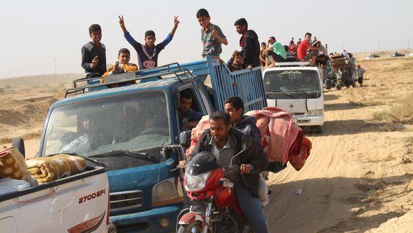Civiles iraquíes - Sputnik Mundo