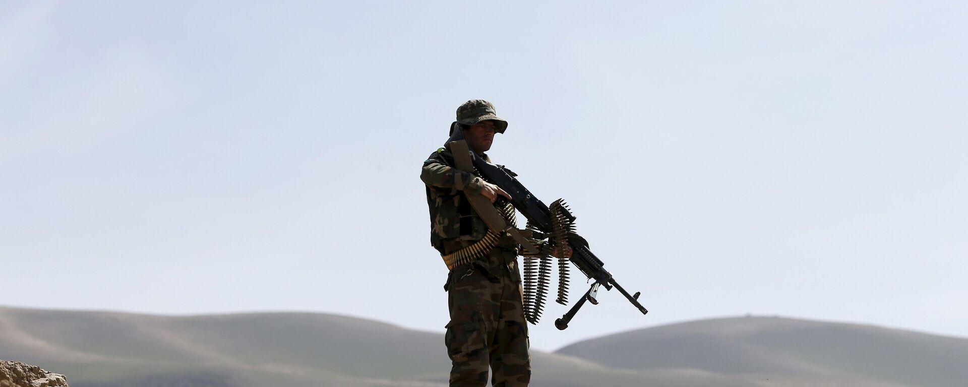 El soldado del Ejército afgano patrulla Dand Ghori, el distrito de Baglan - Sputnik Mundo, 1920, 05.08.2021