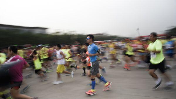 Maratón en China (archivo) - Sputnik Mundo