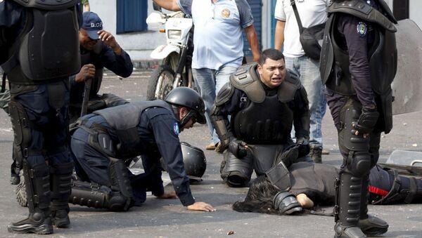 Mueren dos policías durante protesta en Venezuela - Sputnik Mundo