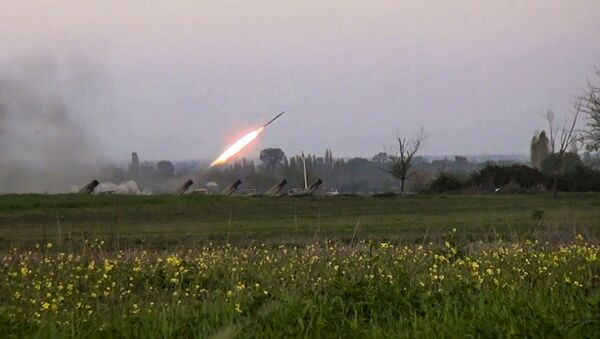 In this image made from video on Sunday, April  3, 2016, a Grad missile is fired by Azerbaijani forces in the village of Gapanli, Azerbaijan. - Sputnik Mundo