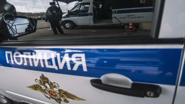 Un coche policial ruso - Sputnik Mundo