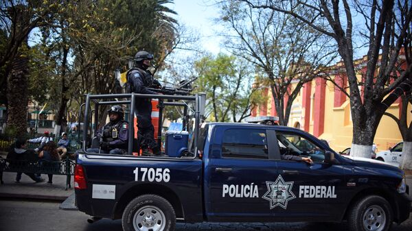 Members of Federal Police patrol the streets of San Cristobal de las Casas, Chiapas State, Mexico on February 12, 2016. Pope Francis will arrive in Mexico on Friday, where he will visit until February 17. - Sputnik Mundo