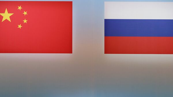 Banderas de Rusia y China - Sputnik Mundo