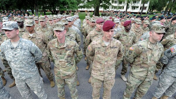 U.S. Army soldiers representing units participating in the the Anaconda-16 military exercise, attend the opening ceremony, in Warsaw, Poland - Sputnik Mundo