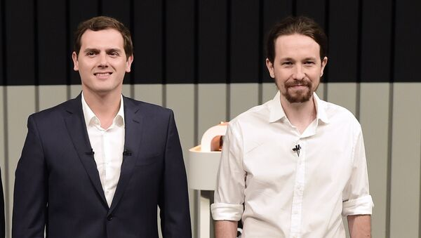 Leader of the People's Party (PP) and Spain's caretaker Prime Minister and party candidate, Mariano Rajoy, Leader of Spanish Socialist Party (PSOE), Pedro Sanchez, Center-right party Ciudadanos leader and party candidate, Albert Rivera,(C), and Leader of left wing party Podemos and party candidate, Pablo Iglesias, pose prior to a televised debate at the congress centre IFEMA in Madrid on June 13, 2016 ahead of Spain's general election. - Sputnik Mundo