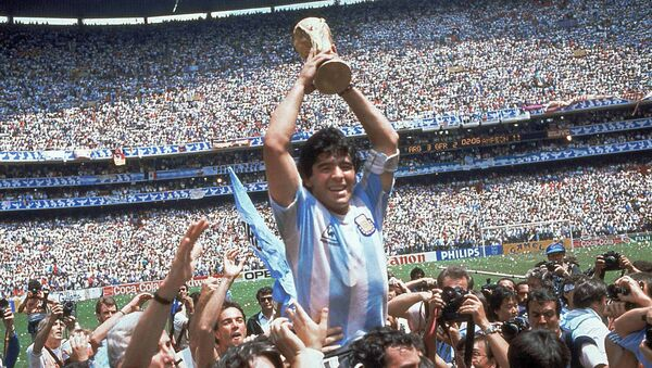 Diego Maradona of Argentina celebrates with the cup at the end of the World Cup soccer final in the Atzeca Stadium, in Mexico City, Mexico - Sputnik Mundo