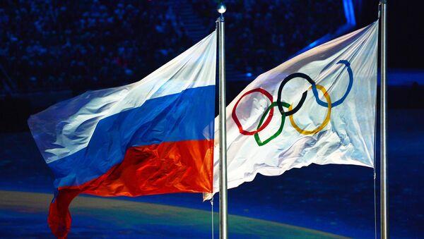 Las banderas de Rusia y de los JJOO (archivo) - Sputnik Mundo
