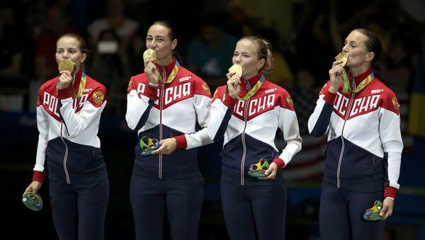 Deportistas rusas con medallas de oro - Sputnik Mundo