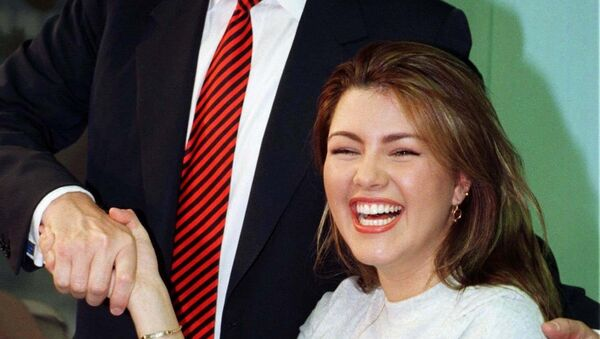 File photo of Miss Universe 1996, Alicia Machado of Venezuela, greeted by businessman Donald Trump during a staged workout at a gym in New York - Sputnik Mundo