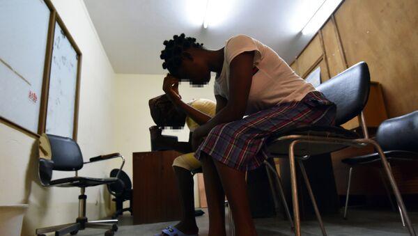 Mujeres liberianas víctimas de violaciones - Sputnik Mundo
