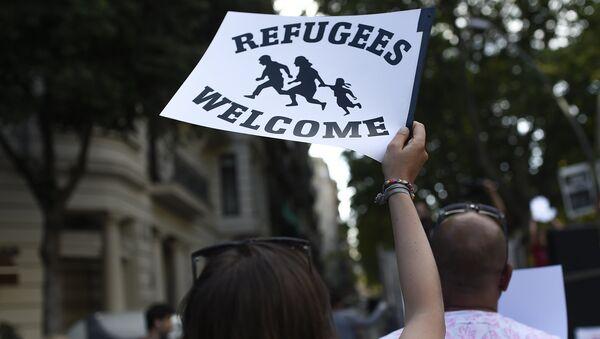 Manifestación en solidaridad con los refugiados (archivo) - Sputnik Mundo