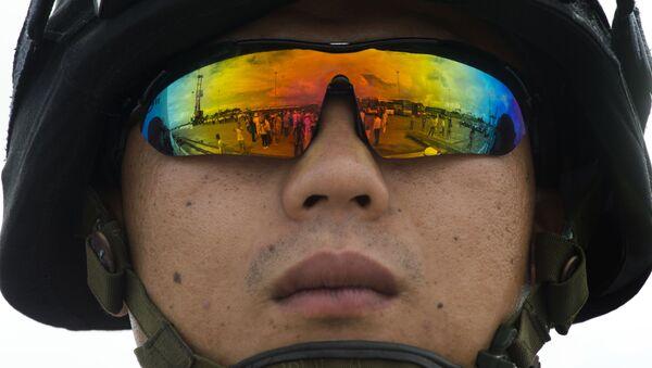Un soldado chino - Sputnik Mundo