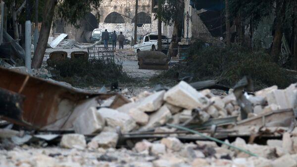 Una zona destruida por la guerra, en Alepo (Siria) - Sputnik Mundo