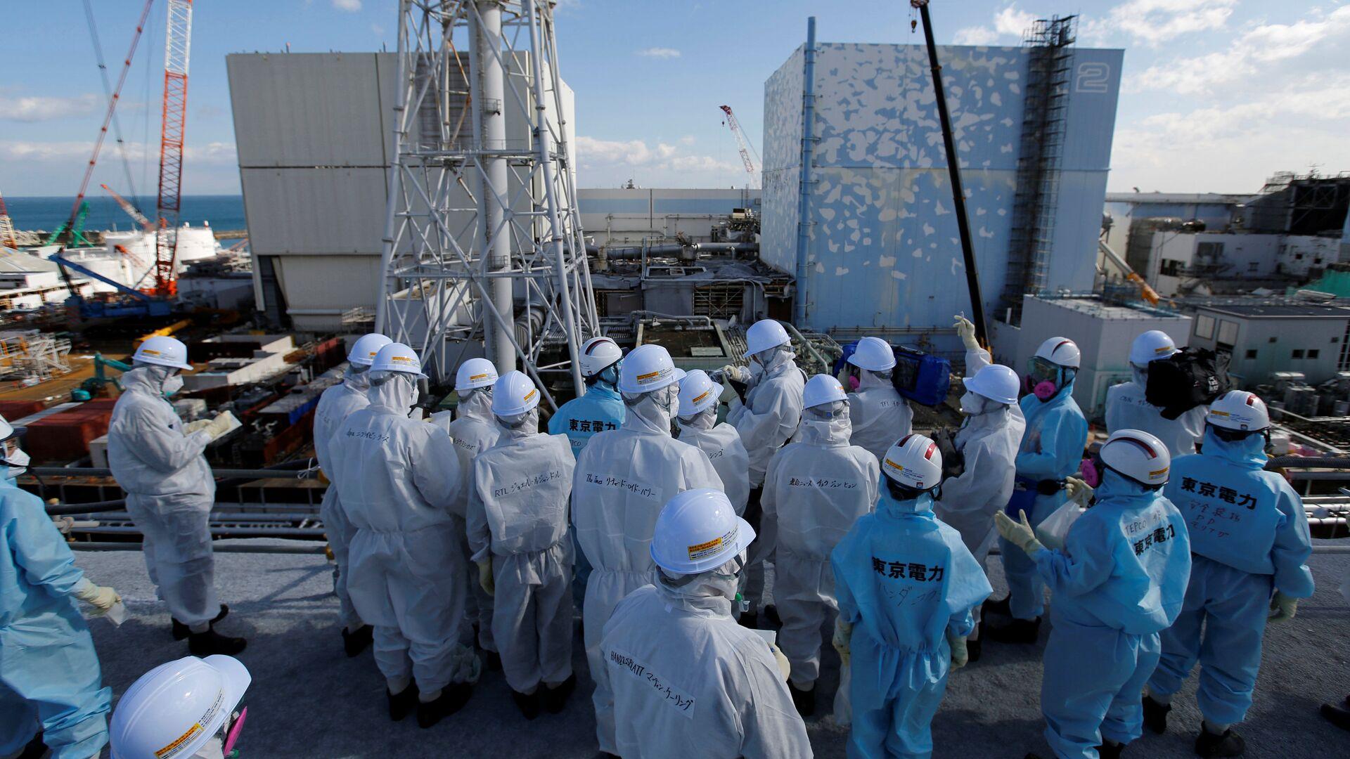 Los medios de comunicación reciben información de los empleados de TEPCO en la planta de energía nuclear Fukushima 1, prefectura de Fukushima, Japón. - Sputnik Mundo, 1920, 11.03.2021