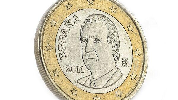 Una moneda de euro en España - Sputnik Mundo