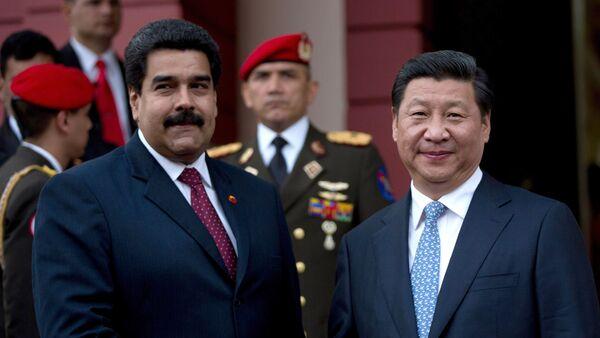 El presidente de Venezuela, Nicolás Maduro, y el presidente de China, Xi Jinping - Sputnik Mundo