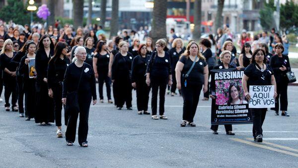 People take part in a demonstration organized by Mujeres de Negro (women in black) against gender violence in Montevideo, Uruguay - Sputnik Mundo