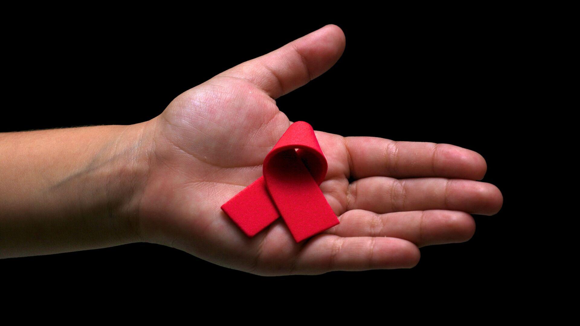 El lazo rojo, símbolo de la lucha contra el VIH y el SIDA  - Sputnik Mundo, 1920, 30.03.2021