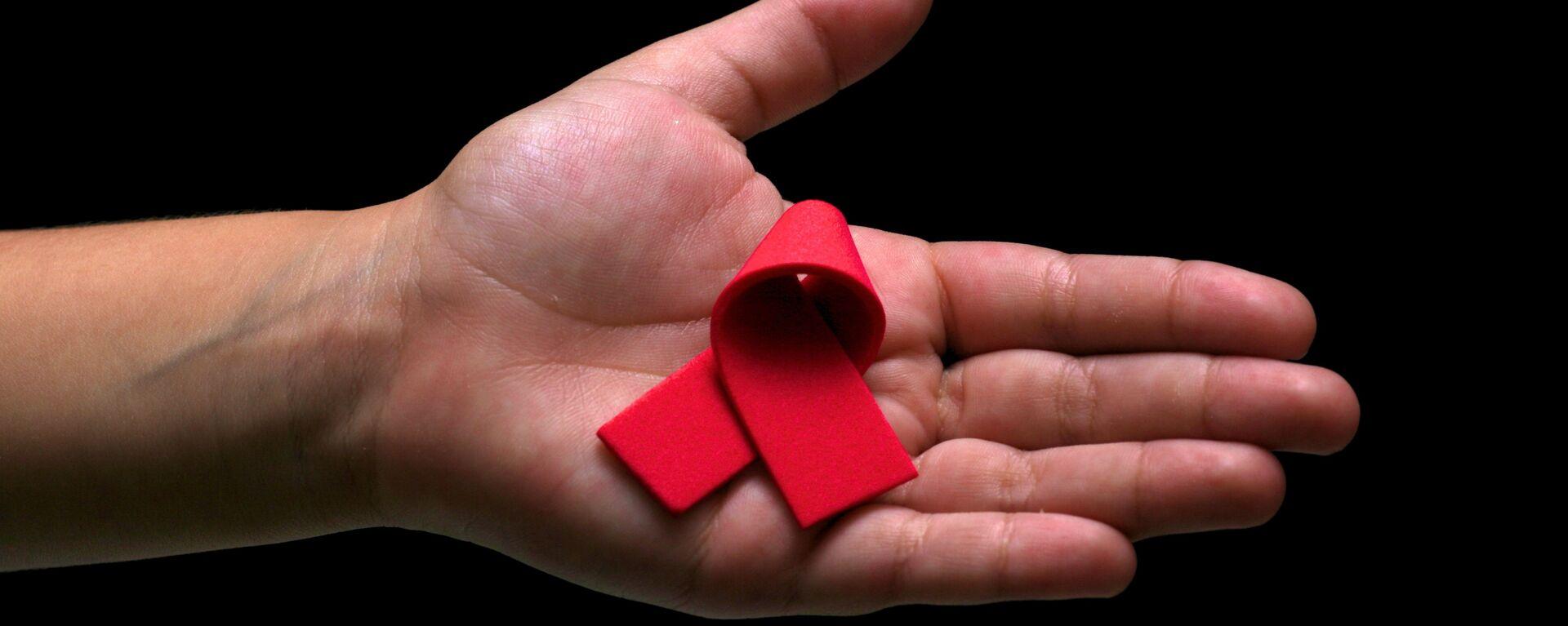 El lazo rojo, símbolo de la lucha contra el VIH y el SIDA  - Sputnik Mundo, 1920, 04.06.2021