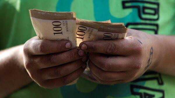 Billetes de bolívares venezolanos (imagen referencial) - Sputnik Mundo
