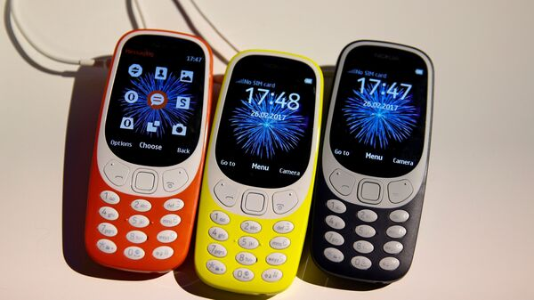 Nokia 3310 devices are displayed after their presentation ceremony at Mobile World Congress in Barcelona, Spain, February 26, 2017. - Sputnik Mundo