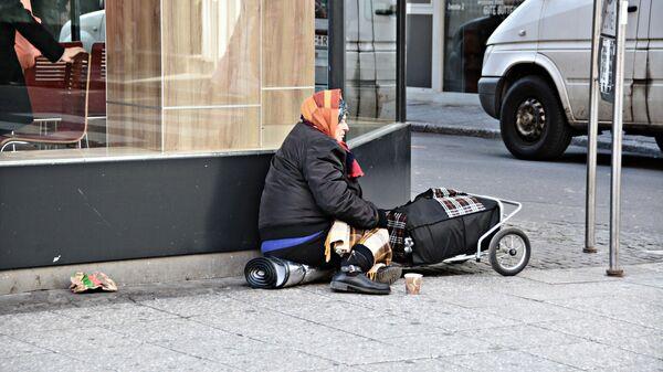 Una persona pobre - Sputnik Mundo
