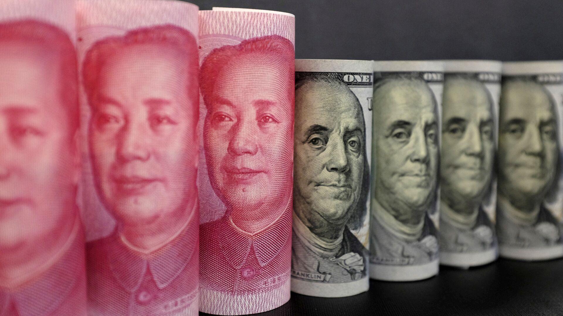 Yuanes chinos y dólares estadounidenses - Sputnik Mundo, 1920, 07.09.2021