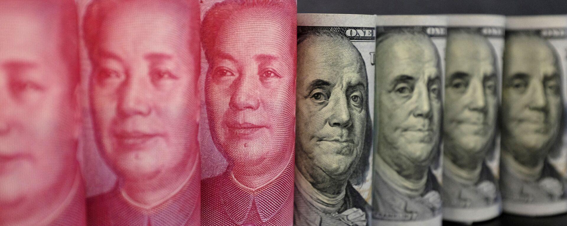 Yuanes chinos y dólares estadounidenses - Sputnik Mundo, 1920, 14.05.2019