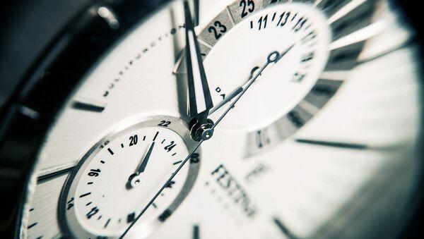 Un reloj - Sputnik Mundo