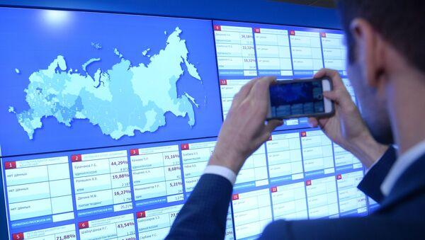 Una pantalla en la Comisión Electoral Central de Rusia (archivo) - Sputnik Mundo