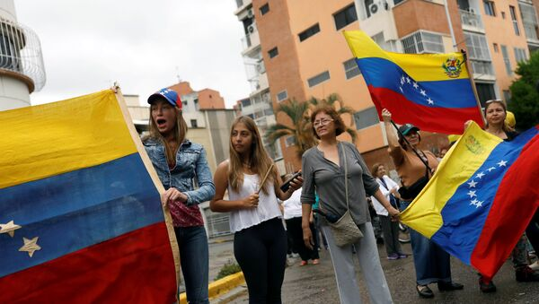 Manifestantes en Caracas, Venezuela - Sputnik Mundo