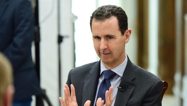 Bashar Asad, presidente sirio, durante la entrevista con la agencia Sputnik - Sputnik Mundo