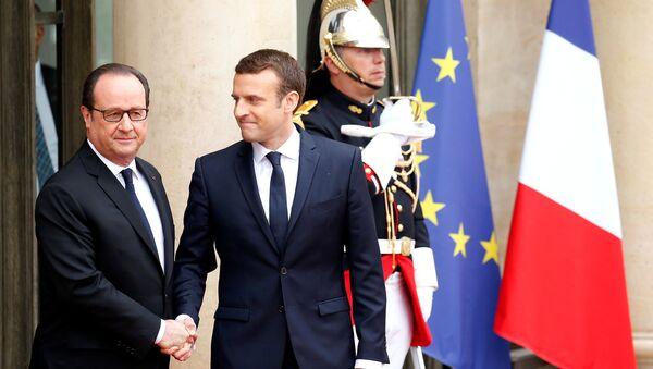 Francois Hollande y Emmanuel Macron - Sputnik Mundo