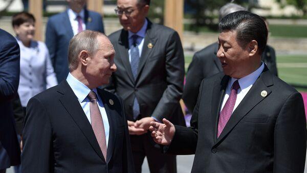 Presidente ruso, Vladímir Putin y presidente chino Xi Jiping - Sputnik Mundo
